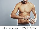 a man with a naked torso with a ... | Shutterstock . vector #1399346735