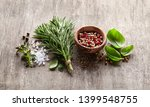 herbs and spices on wooden board | Shutterstock . vector #1399548755