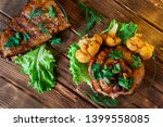 delicious grilled pork ribs and ... | Shutterstock . vector #1399558085