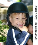 Smiling kid with a helmet on his head - stock photo