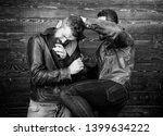 Stock photo street fight concept men brutal hooligans wear leather jackets fighting physical attack men 1399634222