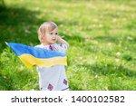 child carries fluttering blue... | Shutterstock . vector #1400102582