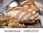 fresh bread on wooden ground   Shutterstock . vector #140012152