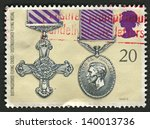 Small photo of UK - CIRCA 1990: A stamp printed in UK shows image of the Distinguished Flying Cross and Distinguished Flying Medal, circa 1990.
