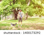 Stock photo dog walker woman enjoying with dogs while walking outdoors 1400173292