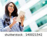happy business woman using a... | Shutterstock . vector #140021542
