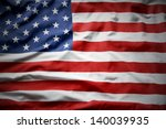 closeup of ruffled american flag | Shutterstock . vector #140039935