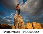 male rock climber celebrates on ...   Shutterstock . vector #1400503055