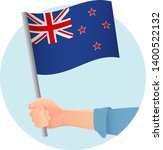 new zealand flag in hand.... | Shutterstock .eps vector #1400522132