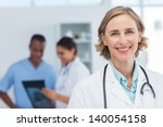 Woman Doctor Smiling And...