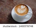 a cup of hot latte art coffee... | Shutterstock . vector #1400578748