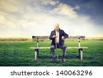 senior man sitting on a bench... | Shutterstock . vector #140063296