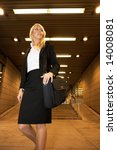 Young Businesswoman Carrying...