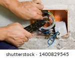 electrician working at... | Shutterstock . vector #1400829545