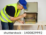 electrician working at... | Shutterstock . vector #1400829992
