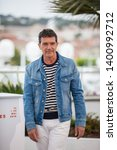 "Small photo of CANNES, FRANCE - MAY 18, 2019: Antonio Banderas attends the photocall for ""Pain And Glory (Dolor Y Gloria/ Douleur Et Glorie)"" during the 72nd annual Cannes Film Festival"