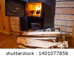 sauna stove  firewood and fire... | Shutterstock . vector #1401077858