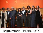 "Small photo of CANNES, FRANCE. May 18, 2019: Antoine Sire, Claude Lelouch, Anouk Aimee, Jean-Louis Trintignant, Monica Bellucci, Marianne Denicourt & Tess Lauvergne at ""The Most Beautiful Years of a Life premiere"