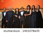"Small photo of CANNES, FRANCE. May 18, 2019: Antoine Sire, Claude Lelouch, Anouk Aimee, Jean-Louis Trintignant, Marianne Denicourt, Monica Bellucci & Tess Lauvergne at ""The Most Beautiful Years of a Life"" premiere"