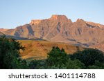 Small photo of Champagne Castle, Cathkin Peak and Monk's Cowl: peaks forming part of the central Drakensberg mountain range, South Africa. Photographed at sunrise when the mountains turn the colour of champagne.