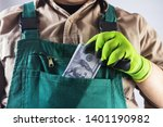 photo of a worker in green... | Shutterstock . vector #1401190982