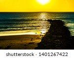 sunset over the ocean in cadiz...   Shutterstock . vector #1401267422