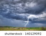 Summer thunderstorm over the meadow in Poland - stock photo