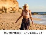 woman enjoying the sunset on a... | Shutterstock . vector #1401301775