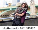 happy couple hugging near the... | Shutterstock . vector #1401301802