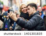 happy couple of tourists taking ... | Shutterstock . vector #1401301835