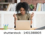 Small photo of Angry african American millennial woman get annoyed using laptop having software problem, mad black female witness computer virus attack or spam, furious biracial girl experience device breakdown