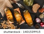 Stock photo appetizing smoked mackerel fish rolls with spices pepper and bread on dark slate background 1401539915