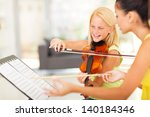 beautiful preteen girl in music ... | Shutterstock . vector #140184346