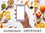 female hands holding smartphone ...   Shutterstock . vector #1401914165
