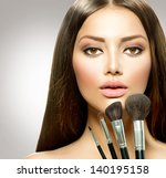 beauty girl with makeup brushes.... | Shutterstock . vector #140195158