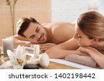 young couple with spa... | Shutterstock . vector #1402198442