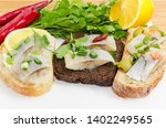 Stock photo three different open sandwiches made with slices of fillet of the pickled atlantic herring and 1402249565