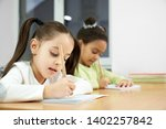 cheerful pretty girls of... | Shutterstock . vector #1402257842