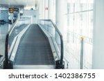 view of a modern travelator... | Shutterstock . vector #1402386755