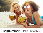 two smiling young female... | Shutterstock . vector #1402429868