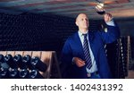 confident male winemaker... | Shutterstock . vector #1402431392