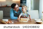 happy family in kitchen. father ...   Shutterstock . vector #1402438832