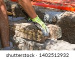 bricklayer making a new wall | Shutterstock . vector #1402512932