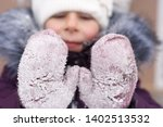 happy child with red cheeks in... | Shutterstock . vector #1402513532