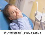 little girl with toothache in... | Shutterstock . vector #1402513535