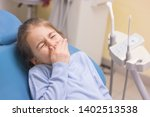 little girl with toothache in... | Shutterstock . vector #1402513538