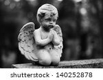 Statue Of A Praying Angel On...