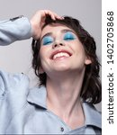 portrait of smiling female in...   Shutterstock . vector #1402705868