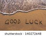 Stock photo good luck words written on the beach 140272648