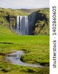 view of the waterfall skogafoss ... | Shutterstock . vector #1402860605
